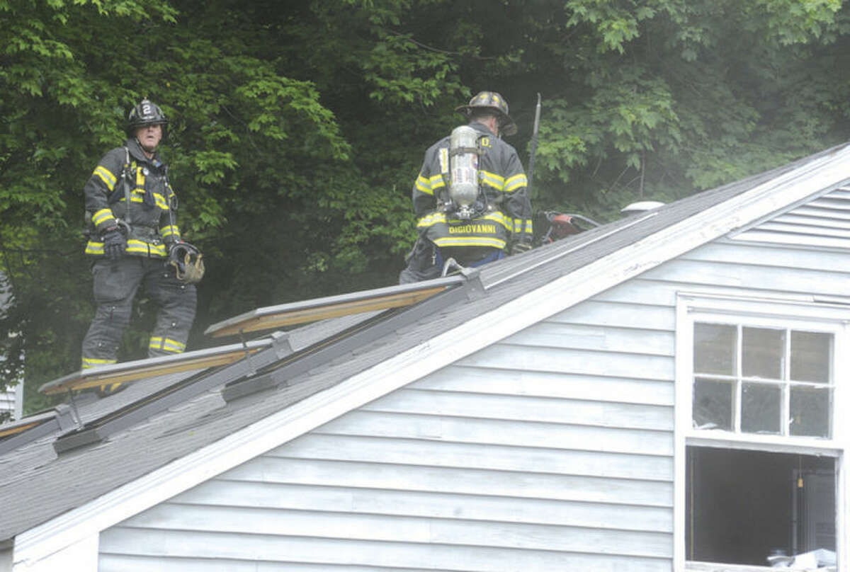 Norwalk fire department work the outside and inside of a garage fire Sunday on Ward Street at around 2:00 in the afternoon. Hour photo/Matthew Vinci