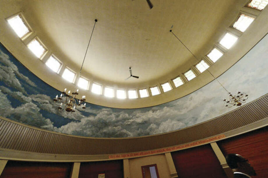 Hour photo / Erik Trautmann Macedonia Church officials take a tour of former First United Methodist Church on West Ave Friday which Macedonia recently bought and intend to rennovate.