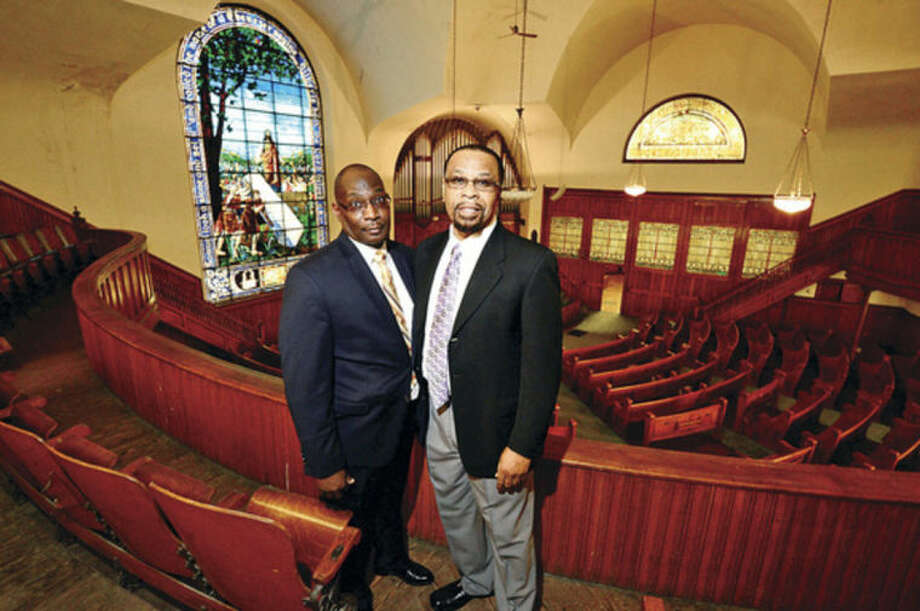 Hour photo / Erik Trautmann Macedonia Church officials, The Rev. DeWitt Stevens and The Rev. Michael Rumble, take a tour of former First United Methodist Church on West Ave Friday which they recently bought and intend to rennovate.