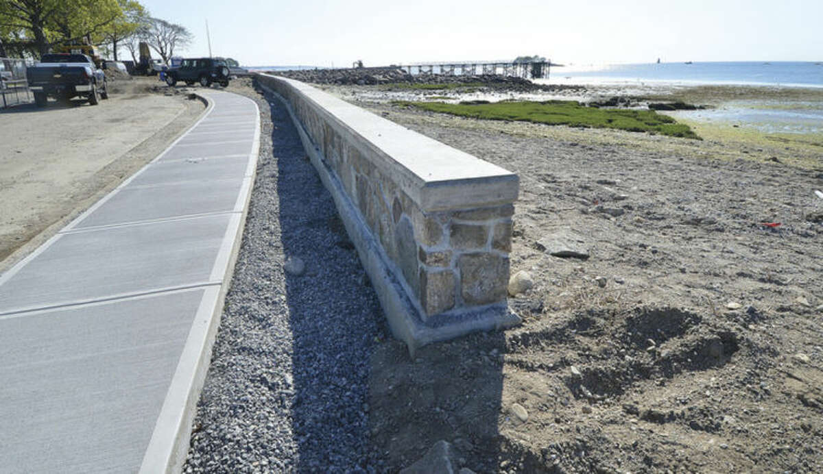 Hour Photo/Alex von Kleydorff The sidewalk and sea wall take shape along the shoreline at Calf pasture Beach