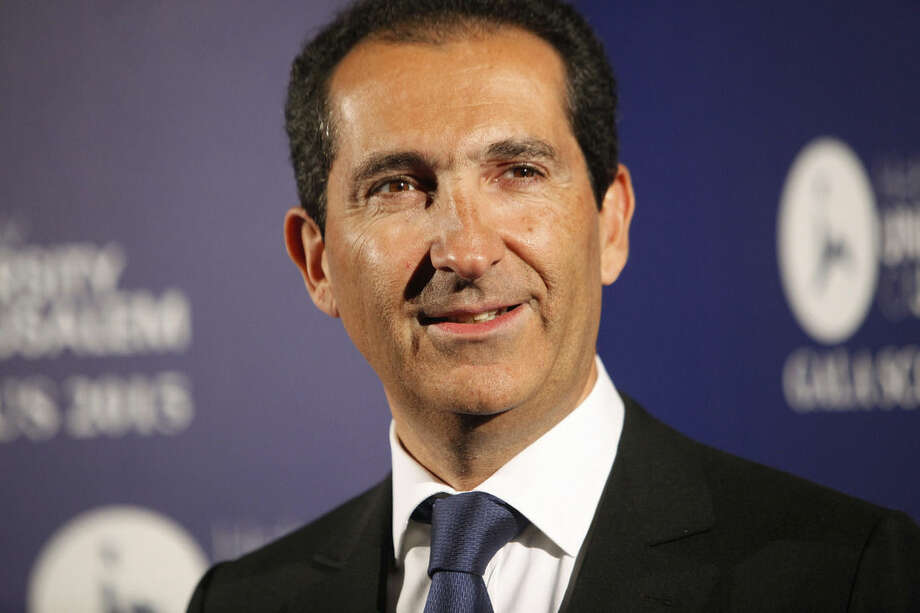FILE - In this March 18, 2015, file photo, Altice group's Chairman Patrick Drahi poses for photographers at the Scopus Awards of the French Friends of the Hebrew University, in Paris, France. The European telecommunications and cable company has agreed to buy New York cable operator Cablevision for $17.7 billion, including debt, according to a person familiar with the matter. The person spoke on condition of anonymity because the deal had not been formally announced. The announcement is expected before European financial markets open Thursday, Sept. 17. (AP Photo/Thibault Camus, File)