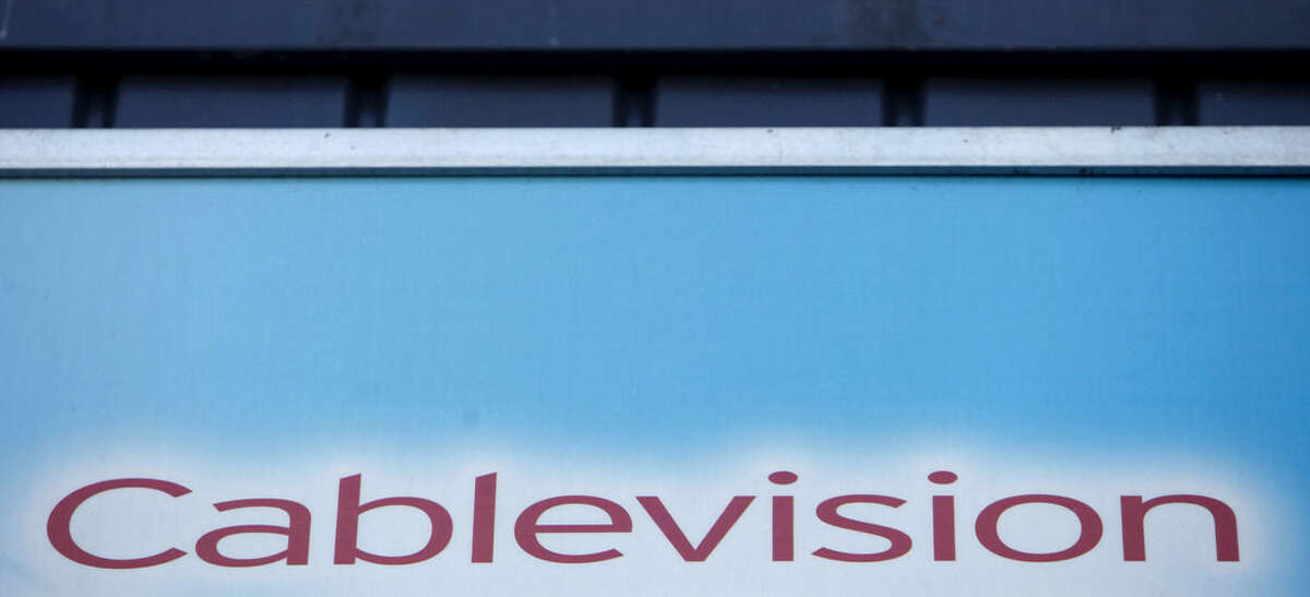 FILE - This file photo made March 7, 2010, shows a Cablevision sign in New York. European telecommunications and cable company Altice has agreed to buy New York cable operator Cablevision for $17.7 billion, including debt, according to a person familiar with the matter. The person spoke on condition of anonymity because the deal had not been formally announced. The announcement is expected before European financial markets open Thursday, Sept. 17. (AP Photo/Seth Wenig, File)