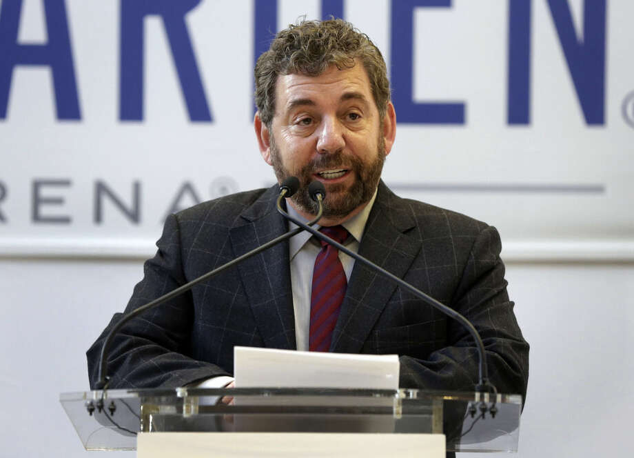 FILE - In this Thursday, Oct. 24, 2013, file photo, Madison Square Garden Chairman James Dolan delivers remarks during ceremonies at the newly-renovated Madison Square Garden, in New York. European telecommunications and cable company Altice has agreed to buy New York cable operator Cablevision, owned by the Dolan family, for $17.7 billion, including debt, the companies announced Thursday, Sept. 17, 2015. (AP Photo/Richard Drew, File)