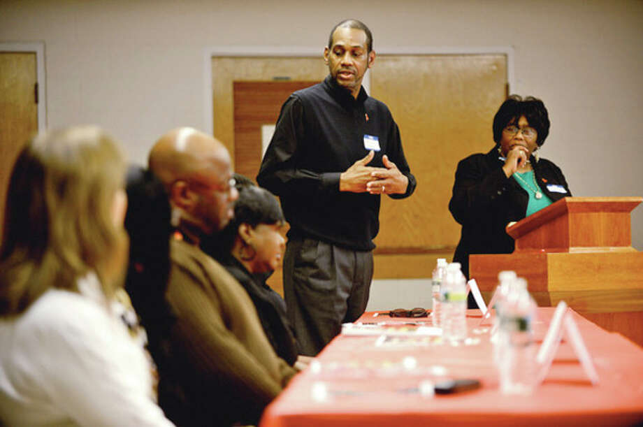"""Hour photo / Erik TrautmannDeacon Michael Askew speaks as part of a panel discussion during World AIDS Day program, """"I am my Brothers/Sisters Keeper"""" sponsored by the Norwalk Health Department HIV/AIDS Program, the Norwalk Branch of the NAACP, Fairfield County Alumni Chapter of Delta Sigma Theta Sorority Inc and Macedonia Church AIDS Ministry, Saturday at Grace Baptist Church. / (C)2012, The Hour Newspapers, all rights reserved"""