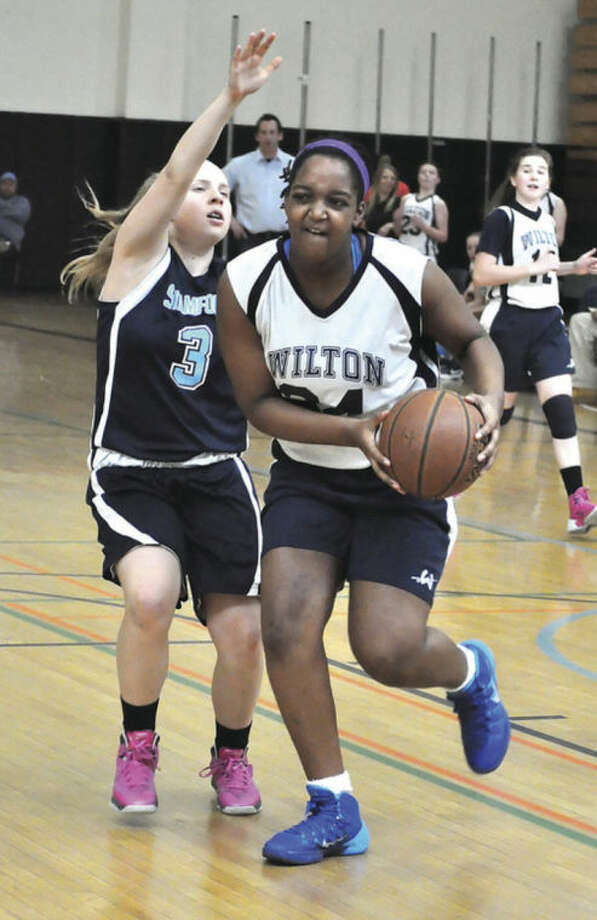 Photo by Hayley MeyerWilton's Adia Burrows, right, drives past a defender during Sunday's championship game.