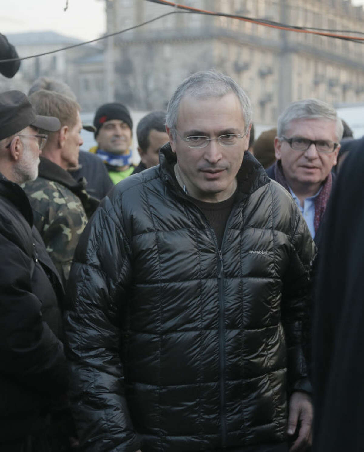 Russian former oil tycoon Mikhail Khodorkovsky goes in the Independence Square to make a speach during a rally in Kiev, Ukraine, Sunday, March 9, 2014. Khodorkovsky, addressing a crowd on the square where demonstrators rose up against Ukraine's Moscow-backed president, said on Sunday Russia had been complicit in police violence against the protesters. (AP Photo/Efrem Lukatsky)