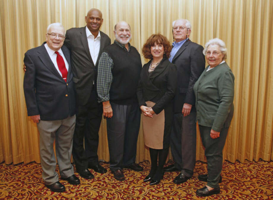 "Hour photo / Danielle CallowayNew members of the Norwalk High School Alumni Association Teacher Honor Roll are, from left: Wesley E. Masten, Robert ""Bobby"" Miller, Steven Wallerstein, for his late father, Mortimer ""Bud"" Wallerstein, Gail Barber-Reed, Randy McCue, and presenter Catherine Vigilante."