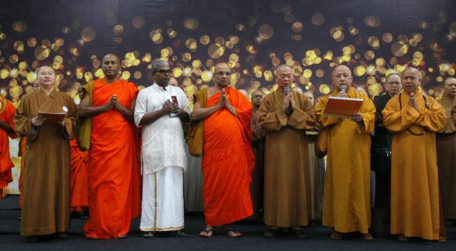 Buddhist monks offer a special prayer for passengers aboard a missing plane, at Kuala Lumpur International Airport in Sepang, Malaysia, Sunday, March 9, 2014. Military radar indicates that the missing Boeing 777 jet of Malaysia Airlines may have turned back, MalaysiaÕs air force chief said Sunday as scores of ships and aircraft from across Asia resumed a hunt for the plane and its 239 passengers. (AP Photo/Lai Seng Sin)