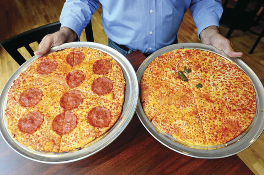 Among Colony Grill's offerings are pepperoni and hot oil thin crust pizzas at its new location in the courtyard of the new Waypointe on West Avenue.