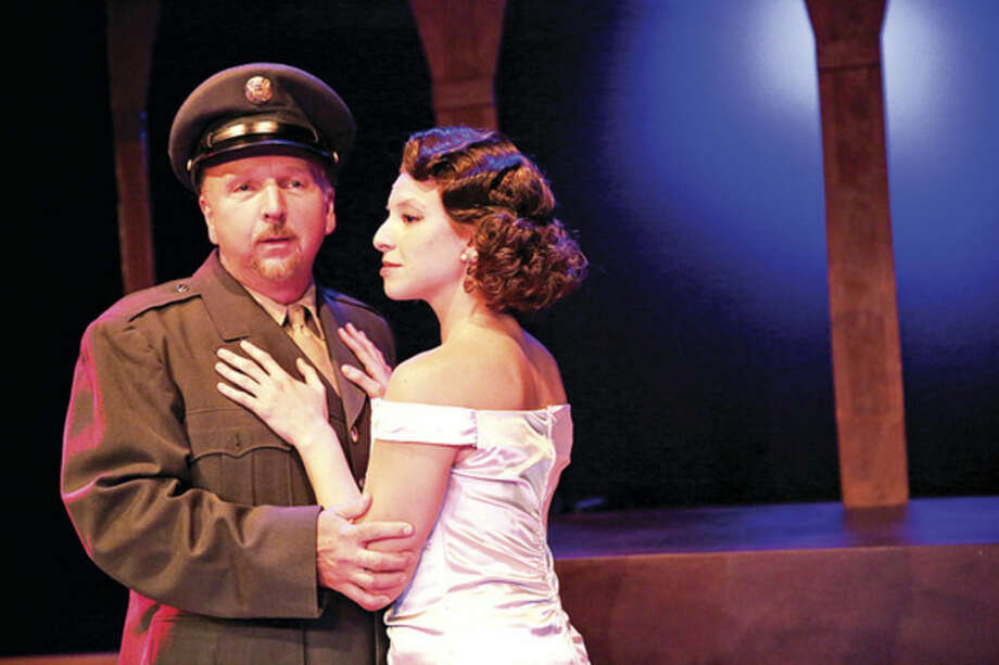 "Hour photo/Chris Palermo Donald Birely and Katerina Papacostas in the production of ""Evita"" at the Music Theatre of Connecticut."