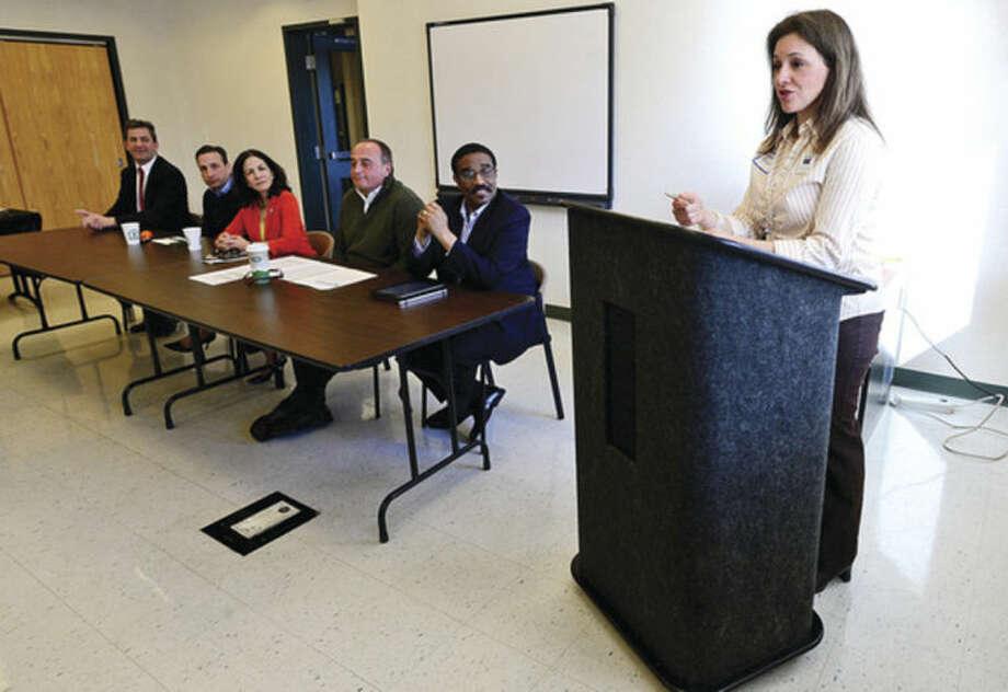 Hour photo / Erik Trautmann Lauren Rosato moderates a community oriented legislative breakfast, Pie and Politics, Saturday morning at the Norwalk Police Department Community Room.