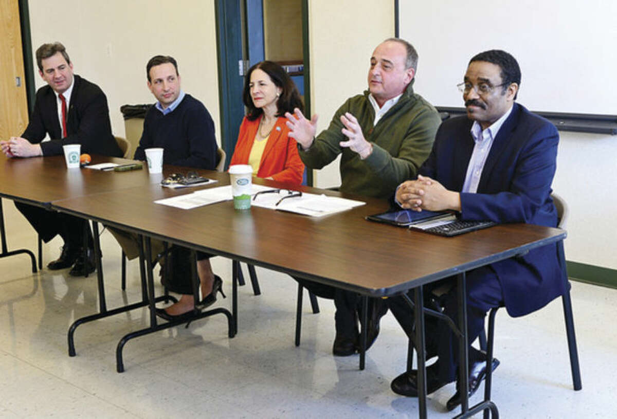Hour photo / Erik Trautmann State Representative Chris Perone, State Senator Bob Duff and State Representatives Gail Lavielle, Larry Cafero and Bruce Morris speak at the community oriented legislative breakfast, Pie and Politics, Saturday morning at the Norwalk Police Department Community Room.