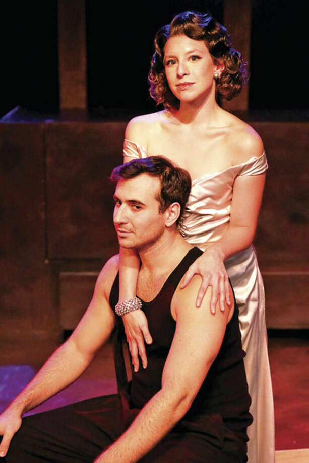 "Hour photo/Chris Palermo Christopher Derosa and Katerina Papacostas in the production of ""Evita"" at the Music Theatre of Connecticut."