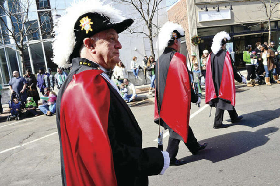 Hour photo / Erik Trautmann John johnson and the Stamford Knights of Columbus participate in The Stamford St. Patrick's Day Parade as it follows last year's parade route proceeding North on Atlantic Street and continuing onto Bedford Street Saturday.