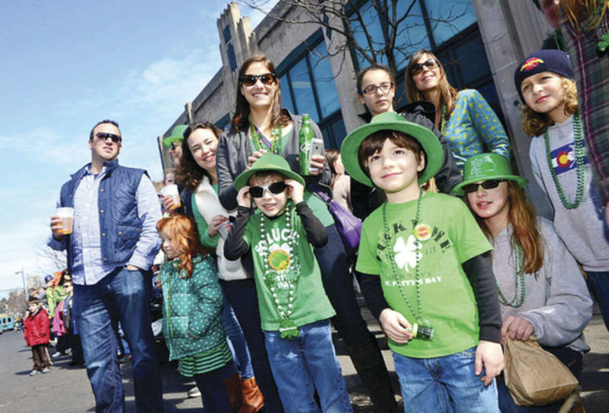 Hour photo / Erik Trautmann Area residents line the streets for The Stamford St. Patrick's Day Parade as it follows last year's parade route proceeding North on Atlantic Street and continuing onto Bedford Street Saturday.