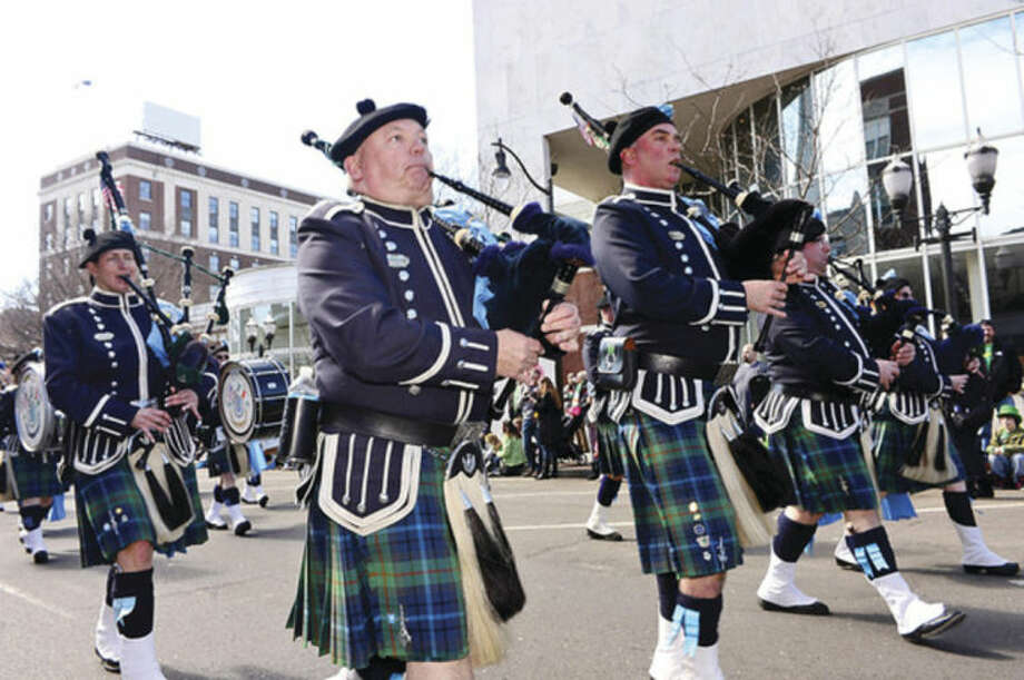 Hour photo / Erik Trautmann The Edward Maloney Pipe Band participates in The Stamford St. Patrick's Day Parade as it follows last year's parade route proceeding North on Atlantic Street and continuing onto Bedford Street Saturday.