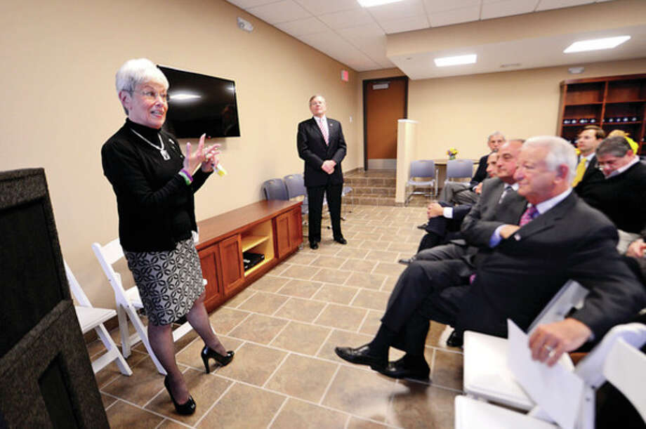 Hour photos / Erik TrautmannAbove, Lt. Gov. Nancy Wyman speaks during the opening of the River Commons Apartments for low-income residents Wednesday. Below, State Rep. Larry Cafero, Mayor Richard Moccia, developer Todd McClutchy, Wyman, tenant Dorothy Greene, developer John McClutchy, State Housing Commissioner Evonne Klein and State Sen. Bob Duff cut the ribbon. / (C)2013, The Hour Newspapers, all rights reserved