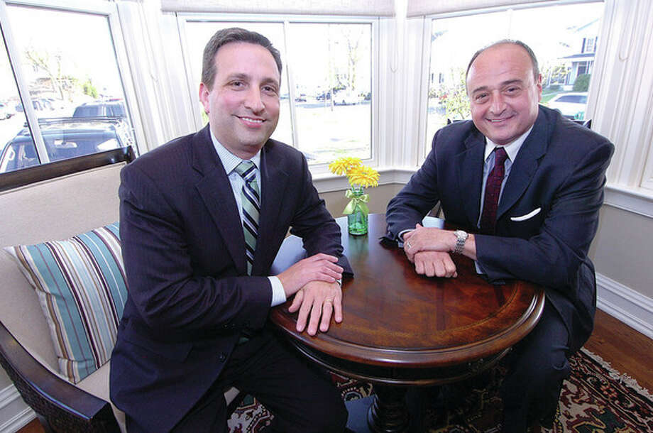 Hour Photo/Alex von Kleydorff State Senator Bob Duff and State Rep Larry Cafero enjoy a seat in one of the deluxe suite sitting areas at The New Grumman St. John hous at The Norwalk Inn and Conference Center / 2013 The Hour Newspapers