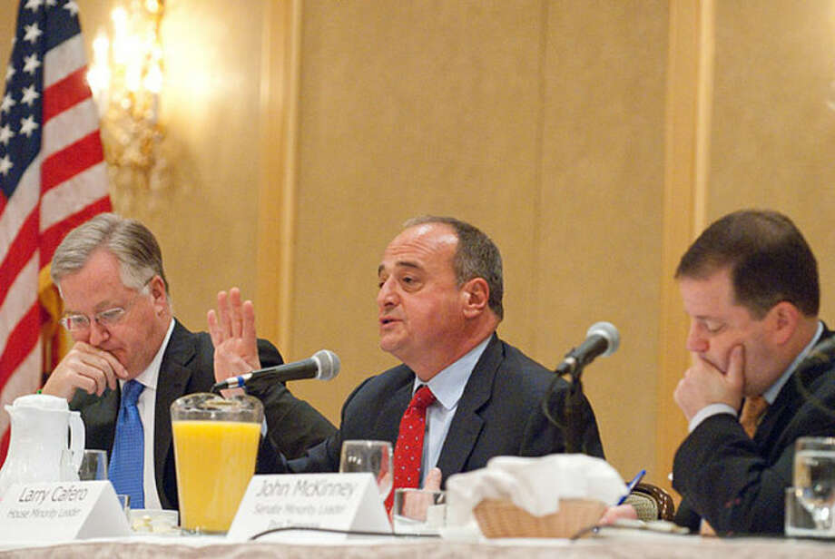 "Photo by Donna Callighan/dcphotodesigns.com Larry Cafero, House Minority Leader, makes a point during the Business Council of Fairfield County's ""Decisions 2013"" event held Tuesday morning at Stamford Plaza Hotel and Conference Center. J. Brendan Sharkey, Speaker of the House, is at left, and John McKinney, Senate Minority Leader, is at right."