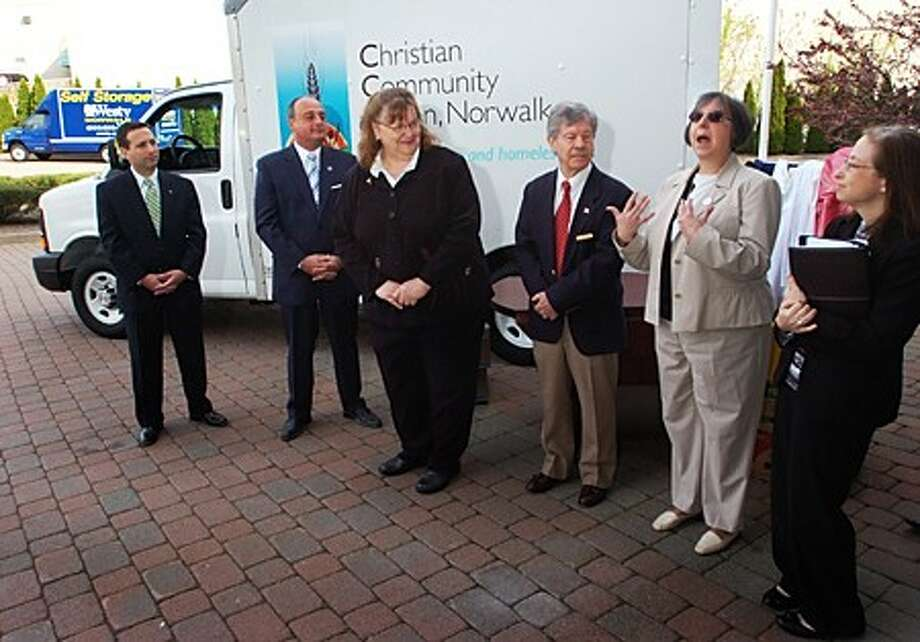 State Senator Bob Duff and State Representative Larry Cafero, Christian Community Action (CCA) Executive Director Christine Pope, Westy Self Storage Director Preston Moore, United Way of Fairfield County Senior Vice President Cathy DeCasare and Fairfield County Community Foundation Vice President of Programs Karen Brown were on hand at Westy Self Storage Wednesday morning to unveil the CCA''s new furniture moving truck to aid in their Furniture Recycling Program. The new truck purchase was made possible by donations from the Fairfield County Community Foundation and the United Way. Hour photo / Erik Trautmann
