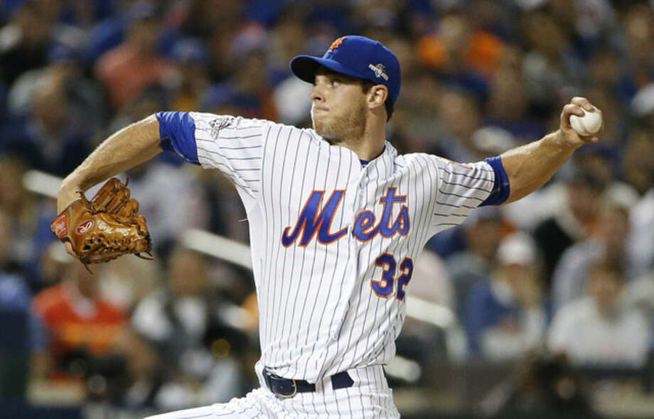 New York Mets pitcher Steven Matz (32) delivers against the Los Angeles Dodgers during the first inning of baseball's Game 4 of the National League Division Series, Tuesday, Oct. 13, 2015, in New York. (AP Photo/Kathy Willens)