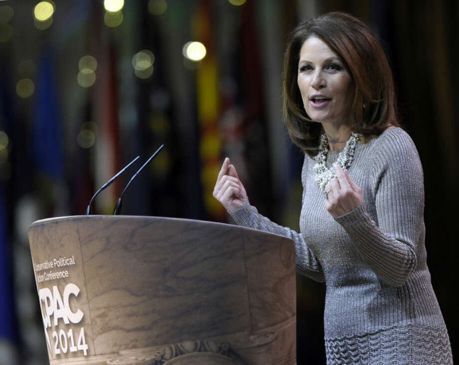 Rep. Michele Bachmann, R-Minn. speaks at the Conservative Political Action Conference annual meeting in National Harbor, Md., Saturday, March 8, 2014. Saturday marks the third and final day of the annual Conservative Political Action Conference, which brings together prospective presidential candidates, conservative opinion leaders and tea party activists from coast to coast. (AP Photo/Susan Walsh)