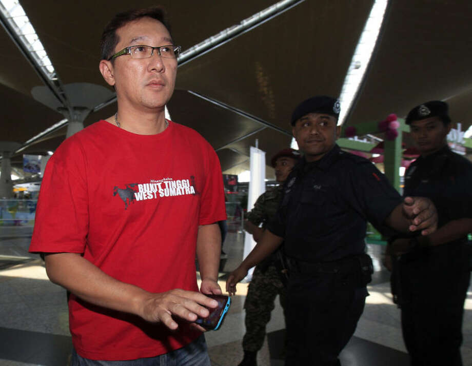 A family member of passengers aboard a missing plane arrives at a reception center at Kuala Lumpur International Airport in Sepang, outside Kuala Lumpur, Malaysia, Saturday, March 8, 2014. A Malaysia Airlines Boeing 777-200 carrying 239 people lost contact over the South China Sea early Saturday morning on a flight from Kuala Lumpur to Beijing, and international aviation authorities still hadn't located the jetliner several hours later. (AP Photo/Lai Seng Sin)