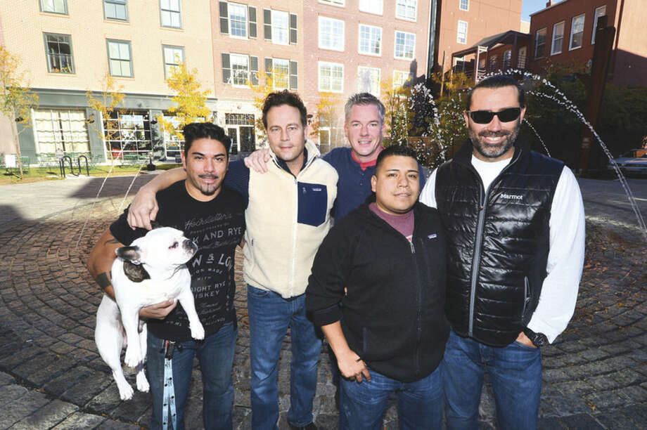 Hour photo/Alex von KleydorffThe Spread restaurant is opening a new restaurant called El Segundo in SoNo Ironworks this winter. From left to right, Pepper the French Bulldog, Partners Andrey Cortes, Chris Rasile, Chris Hickey, Executive Chef Carlos Baez and Partner Shawn Longyear, in the Ironworks Courtyard with their new space behind.