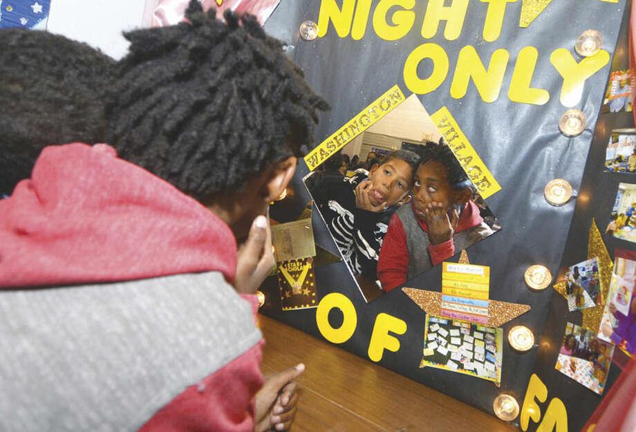 Hour photo/Alex von KleydorffThird graders Dewayne Singleton and Sincere Kendrick make faces in a mirror as part of a diorama during Nathaniel Ely Lights On Afterschool program Friday evening.