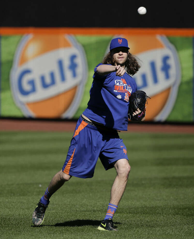 New York Mets starting pitcher Jacob deGrom throws in the outfield during a voluntary team workout, Friday, Oct. 23, 2015, in New York. After sweeping the Chicago Cubs to win the NLCS, the Mets will play in the World Series against the winner of the ALCS. (AP Photo/Julie Jacobson)