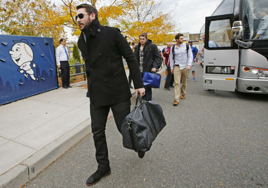 New York Mets pitcher Matt Harvey, left, and Steven Matz, third from left, walk to the parking lot at Citi Field after the Mets plane landed in New York from Chicago Thursday, Oct. 22, 2015. The Mets won the National League Championship pennant after sweeping the Chicago Cubs four games to none. (AP Photo/Kathy Willens)