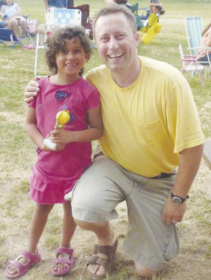 Contributed photoIsabella Emma Icatar with her softball coach.