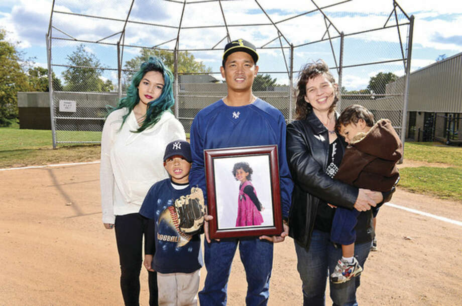 Hour photo/Erik TrautmannRoneil Icatar and his family; daughter Annalise, wife Julianne and sons Giancarlo and Nathaniel Icatar at New Marvin Softball Field. The Common Council on Tuesday evening approved naming The Marvin Elementary School softball field after Isabella Emma Icatar, a Norwalk girl who played softball there and died of brain cancer at the age nine.
