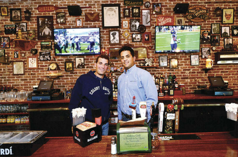 Hour photos/Erik TrautmannColony Grill Development CEO Paul Coniglio and Director of Operations Ken Martin in their new restaurant in the courtyard of the new Waypointe on West Avenue in Norwalk.
