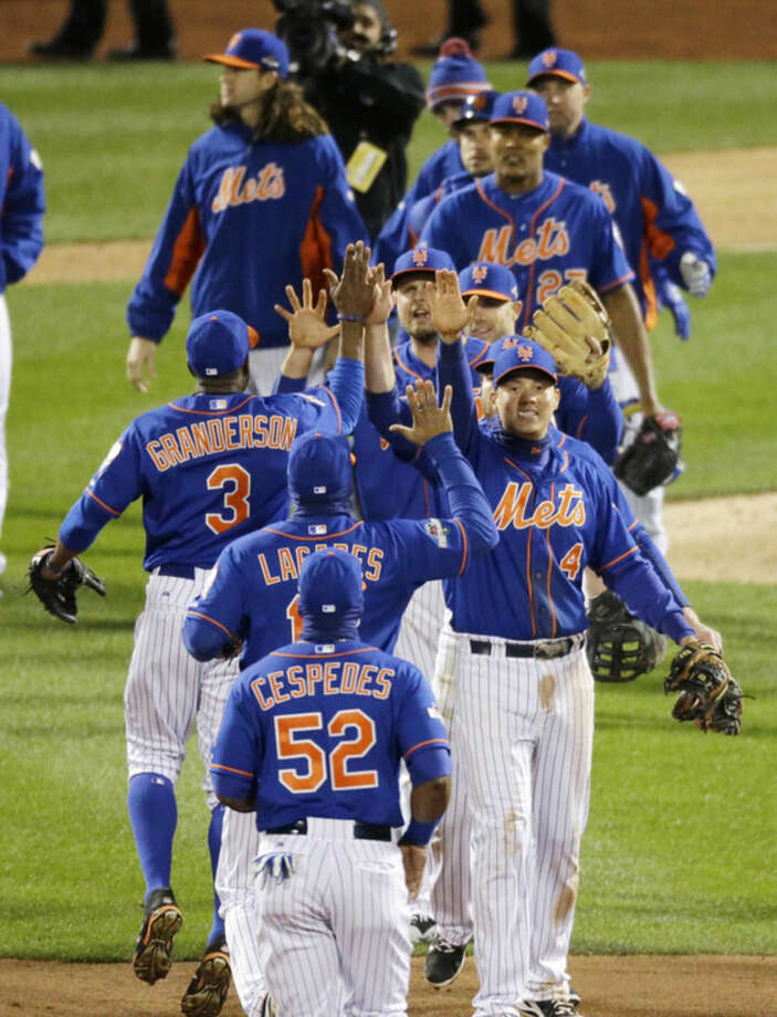 New York Mets celebrate after Game 1 of the National League baseball championship series against the Chicago Cubs Saturday, Oct. 17, 2015, in New York. The Mets won 4-2 to take a 1-0 lead in the series. (AP Photo/David Goldman)