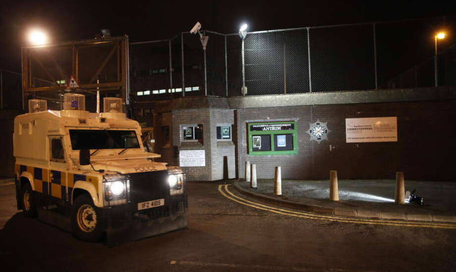 A Police vechicle leaves Antrim Police station in Northern Ireland, Wednesday, April, 30, 2014. Sinn Fein leader Gerry Adams has been arrested and is being questioned at Antrim police station about the 1972 murder of Jean McConville. (AP Photo/Peter Morrison)