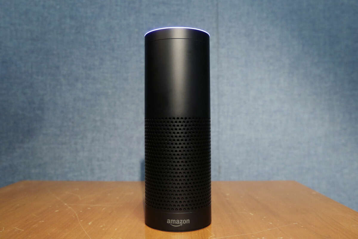 FILE - This July 29, 2015 file photo shows Amazon's Echo speaker, which responds to voice commands, in New York. The $180 cylindrical device is the latest advance in voice-recognition technology that's enabling machines to record snippets of conversation that are analyzed and stored by companies promising to make their customers' lives better. (AP Photo/Mark Lennihan, File)