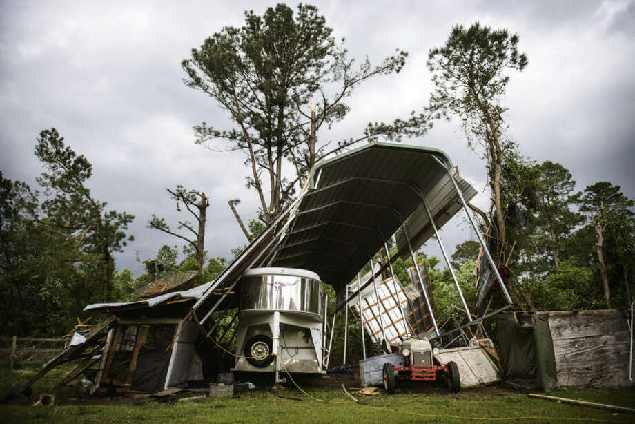 Larry Smith's camper shelter near Stedman, N.C., was destroyed after a possible tornado passed by his house Tuesday, April 29, 2014. At least five counties in eastern North Carolina reported tornadoes on Tuesday. (AP Photo/The Fayetteville Observer, James Robinson)