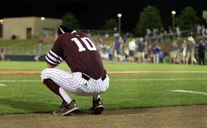 Texas A&M's Andrew Vinson (10) reacts as TCU players celebrate their 4-1 win in a NCAA college baseball super regional tournament game on June 12, 2016, in College Station.