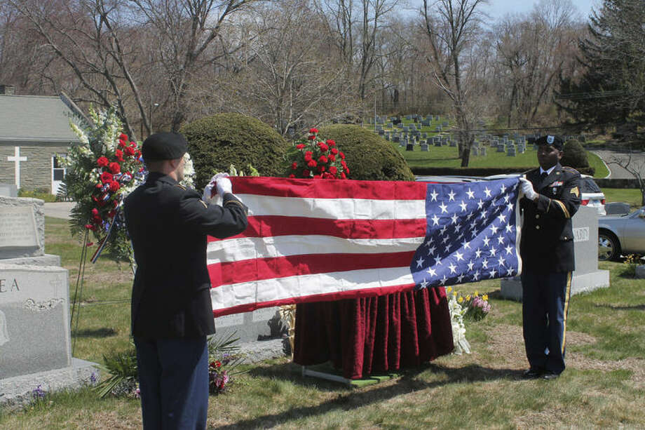 Contributed photoA Flag of Honor is folded as William J. Lyons Jr. is laid to rest Friday.