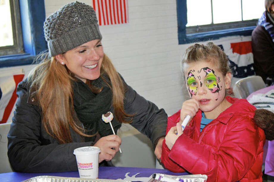 A mother and daughter enjoy some arts and crafts during Pony Rides For A Purpose in Newtown, CT last year.Hour Photo / Danielle Calloway
