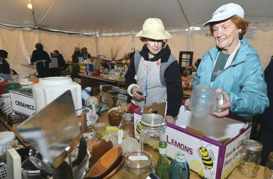 Susan Florido and Marianne McCarthy organize and price some canning jars up for sale at Wilton's Minks to Sinks Sale.