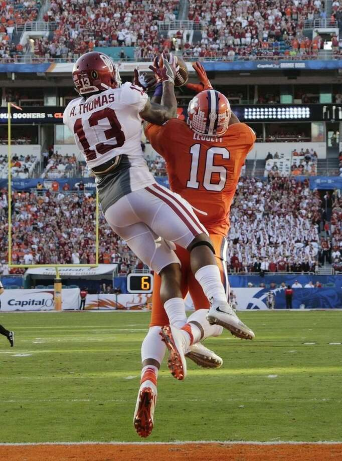 Oklahoma safety Ahmad Thomas (13) attempts to intercept a pass intended for Clemson tight end Jordan Leggett (16), during the first half of the Orange Bowl NCAA college football semifinal playoff game, Thursday, Dec. 31, 2015, in Miami Gardens, Fla. (AP Photo/Lynne Sladky)