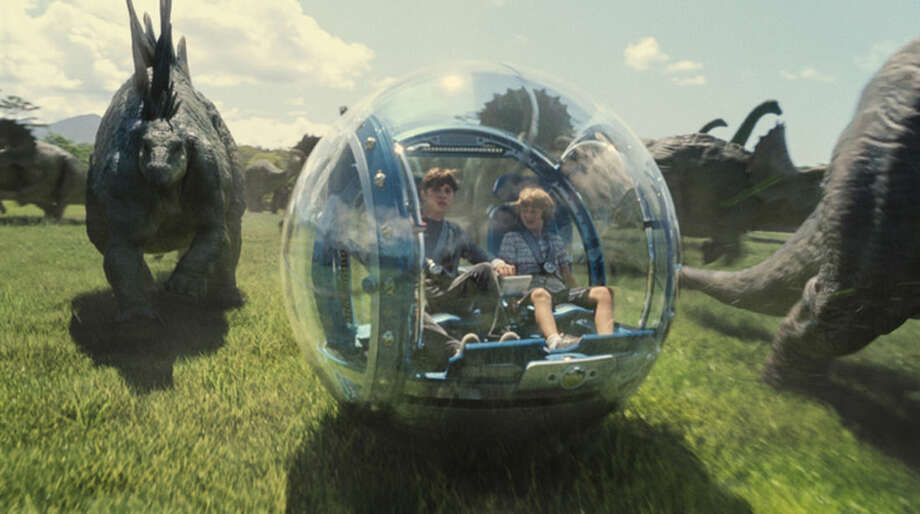 "This photo provided by Universal Pictures shows, Nick Robinson, left, as Zach, and Ty Simpkins as Gray, in a scene from the film, ""Jurassic World,"" directed by Colin Trevorrow, in Steven Spielberg's groundbreaking ""Jurassic Park"" series. The Universal Pictures 3D movie released in theaters on June 12, 2015. (ILM/Universal Pictures/Amblin Entertainment via AP)"
