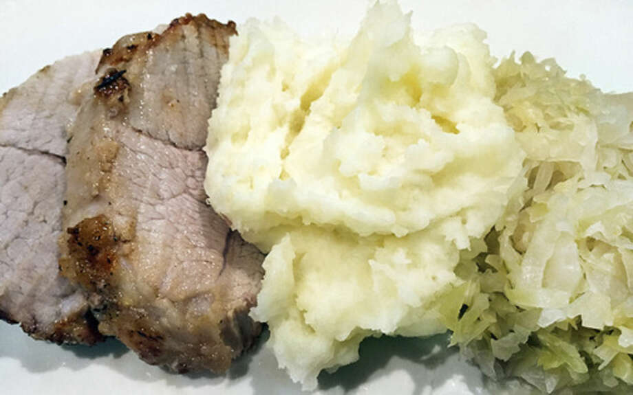 Contributed photoRoast pork with sauerkraut and mashed potatoes, a New Year's tradition.