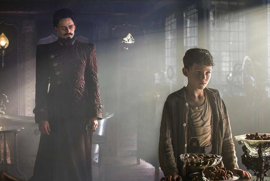 """This image released by Warner Bros. Pictures shows Levi Miller, right, and Hugh Jackman in a scene from the film, """"Pan."""" (Laurie Sparham/Warner Bros. Pictures via AP)"""