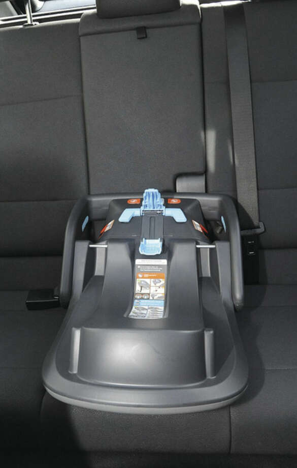 Hour photo/Matthew VinciThe base of a baby car seat installed at the Norwalk Police Headquarters.Police encourage parents to have the seats professionally installed and give step by step demonstrations and advice as they put the seats in.
