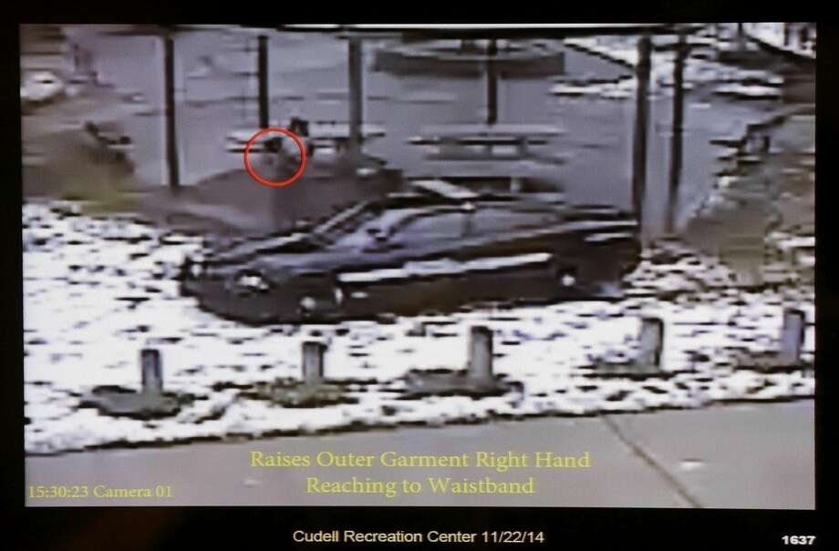 FILE - This Nov. 26, 2014 file photo shows a still image taken from a surveillance video recorded on Nov. 22, 2014, that was played at a news conference held by Cleveland Police. It shows Cleveland police officers arriving at Cudell Park on a report of a man with a gun. Twelve-year-old Tamir Rice was fatally shot by Cleveland police, Nov. 22, 2014, after he reportedly pulled a replica gun at the city park. Cuyahoga County prosecutor Tim McGinty announced Monday, Dec. 28, 2015, that a grand jury declined to indict the officer. (Cuyahoga County Prosecutor's Office via AP, File)