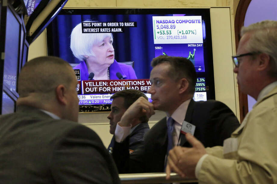 FILE - In this Wednesday, Dec. 16, 2015, file photo, Federal Reserve Chair Janet Yellen's Washington news conference is shown on a television screen on the floor of the New York Stock Exchange. Wall Street watched few things more closely this year than the Federal Reserve. Despite veering between record highs and the steepest dive in four years, the stock market is on track to end the year essentially flat. (AP Photo/Richard Drew, File)