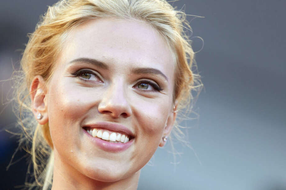 "FILE - In this Sept. 3, 2013 file photo, actress Scarlett Johansson poses for photographers on the red carpet for the screening of the film ""Under The Skin"" at the 70th edition of the Venice Film Festival in Venice, Italy. Johansson is ending her relationship with Oxfam International after being criticized over her support for an Israeli company that operates in the West Bank. (AP Photo/Andrew Medichini, File)"
